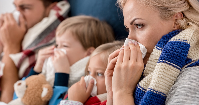 Close-up Shot Of Sick Young Family Blowing Noses With Napkins To