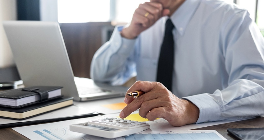 Man making calculations for taxes